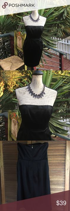 Express Design Studio Strapless Cocktail Dress New without tag - never worn. Beautiful fully lined black satin dress with rubber lining inside dress to keep in place, hidden zipper with hook closure, & 2 front pockets.  🌷I sell the necklace too.🌷 Express Dresses Strapless