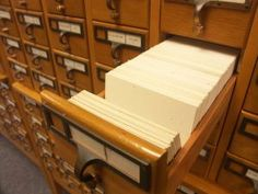 Using a card catalog at the library