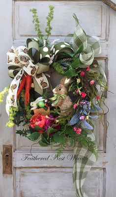Oh my Goodness...I love this Sisal Mama Bunny strolling her Baby in the Cart!! This Wreath is Built on a Grapevine Base. I have layered it with Twiggy Moss Branches, Wispy Pink Flowers, Spriggy Greens that have the look of a Carrot Top, Assorted Greenery, a Fuchsia and Coral