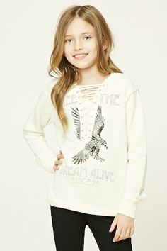 """Forever 21 Girls - A knit sweatshirt featuring a """"Keep The Dream Alive Since 79"""" and an eagle graphic on front, lace-up front with grommets, French terry cloth lining, ribbed trim, and long sleeves."""
