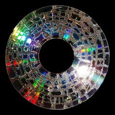 Microwaving a CD for 10 seconds reveals the concentric circle pattern of the CD surface, which is otherwise undetected by the naked eye.  Read more: http://bit.ly/1oBYhO9 via Princeton University