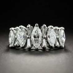 A quintet of bright white and sparkling marquise diamonds alternate with opposing pairs of tapered baguette diamonds, creating a fabulous flash across your finger in this blazingly beautiful mid-century jewel hand fabricated in platinum. 2.00 carats total diamond weight. Currently ring size 5+.