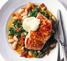 Smoky hake, beans & greens is part of Smoky Hake Beans Greens Recipe Bbc Good Food - Grill white fish fillets and serve on top of chorizo, cannellini beans and spinach for a quick dinner that packs in 3 of your 5 a day Hake Recipes, Seafood Recipes, Dinner Recipes, 5 A Day Recipes, Salmon Recipes, Tuna Steak Recipes, White Fish Recipes, Dinner Ideas, Bbc Good Food Recipes
