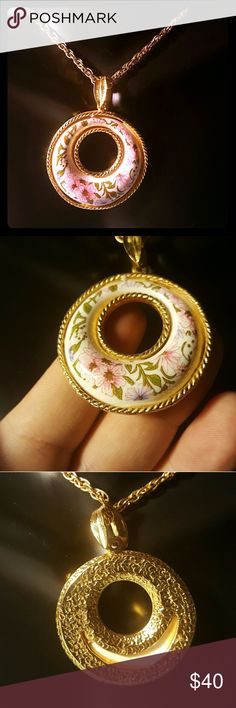 Beautiful VTG Circle Necklace This is a very pretty and unique vintage circle necklace with a long chain and flower pattern printed on it. Mint condition. Vintage Jewelry Necklaces