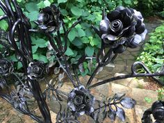 "Wonderful, well executed metal ""rose fence."" Gibbs Gardens"