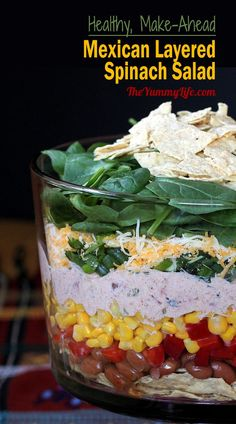 Healthy, Make-Ahead Mexican Layered Spinach Salad with a low calorie yogurt dressing and nutrient-rich vegetables. From TheYummyLife.com