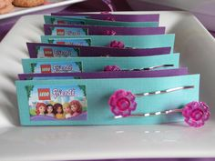 Lego Friends hair pins made from Lego Flowers  #legofriends #birthday #party #favors http://partyatthebeech.blogspot.com/2013/08/emilys-lego-friends-birthday-party.html