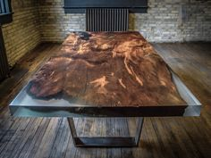 """Square Cut Burl  This 2500-4000 year old redwood burl is certified through the Forest Stewardship Council. It is """"square-cut"""" and contains clear, cast resin in each of its natural voids."""