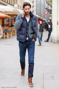Shop this look on Lookastic:  http://lookastic.com/men/looks/boots-skinny-jeans-crew-neck-t-shirt-cardigan-gilet/4405  — Brown Leather Boots  — Navy Skinny Jeans  — White Crew-neck T-shirt  — White and Navy Horizontal Striped Cardigan  — Navy Quilted Gilet