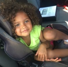 Beautiful baby girl with hazel green eyes and curly hair
