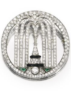 An Art Deco Platinum, Diamond, Emerald and Enamel Brooch, Cartier, Circa 1925. Designed as a fountain, set throughout with numerous old European and single-cut, accented by calibré-cut emeralds and black enamel, signed Cartier, numbered. #Cartier #ArtDeco #brooch