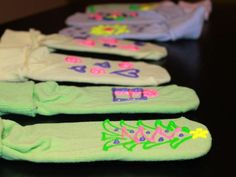 These no-slip socks are a perfect gift for children to make for their cousins, siblings, or friends!     What You'll Need    new, washed socks  cardboard  scissors  puffy paint