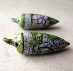 Blue, green and rose crackle pods by Claire Maunsell.