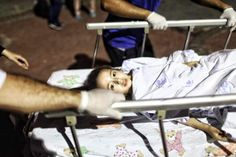 A child is taken out of the airport on a stretcher after an attack at the largest airport in Istanbul. (Getty)