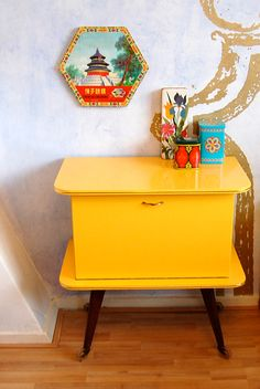 waiting for the sun! via All The Luck in The World. {<3 the bright yellow + Chinese board game (跳棋) package on the wall.}