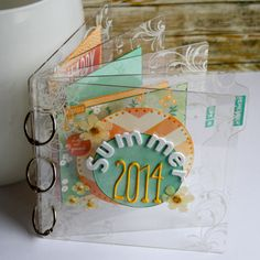 mini album using StazOn Cotton White + Mustard, irRESISTible Pico Embellisher Gold, Memento Cottage Ivy + Cantaloupe, Craft Mat, Ink Blushers and StazOn Cleaner along with a clear 6x6 Tab Album from Clear Scraps
