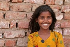 https://flic.kr/p/61f2xZ | Spotted Smile | Big grin from the slum at Gulbai Tekra.  I maintain that you'll see more people smiling in a slum in India than you will in the CBD of more affluent cities across the globe. Food for thought.