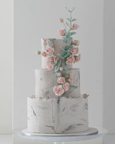 Marble/stone wedding cake with climbing roses