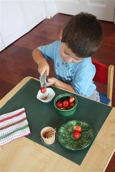 A small table in or near the kitchen + a simplified activity = a child who helps happily with all kinds of food prep tasks.