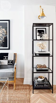 An elegant étagère neatly shows off the homeowner's collection of inspiring coffee table books and objets. | Image: Stacey Brandford | Styling: Ann Marie Favot