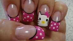 Coat your nails in deep pink and clear polish with white polka dots and Hello kitty's adorable face. Lined with black acrylic and topped with Hello Kitty's pink bow, this is simply a must do for Hello kitty enthusiasts.