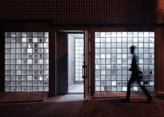 Assorted glass blocks give varying levels of translucency to the facade of this showroom and storage facility for an antiques dealer in Osaka, Japan