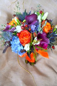 October Weeding love these colors the blue would go great with your dress and orange is the perfect contrasting color Kristina England