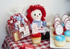 Raggedy Ann Party table with Favor, birthday girl's candle in her cupcake, a favorite Raggedy Ann Doll and cupcakes. Baby Birthday, Birthday Party Themes, Birthday Ideas, Lauren Kate, Raggedy Ann And Andy, Nautical Baby, Party Cakes, Party Planning, First Birthdays