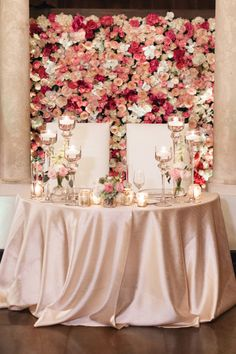 Wall of Flowers Behind Sweetheart Table   photography by http://www.elainepalladinoblog.com