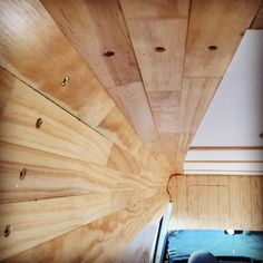 Finishing off some varnishing where the wall curves to the ceiling #vanlifeproject
