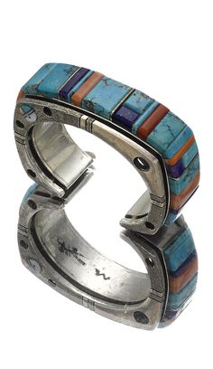 Cuff | Wes Willie (Navajo).  Sterling silver with turquoise, coral, spiny oyster, lapis, spiny oyster and sugilite, a raised panel with kachina face motif on one side