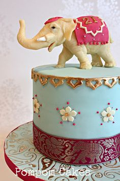 This was a 21st birthday cake for a girl who loves elephants. Loved making this one. Coffee sponge with mocha swiss meringue buttercream (thank you Flickr girls for your advice on the recipe!).