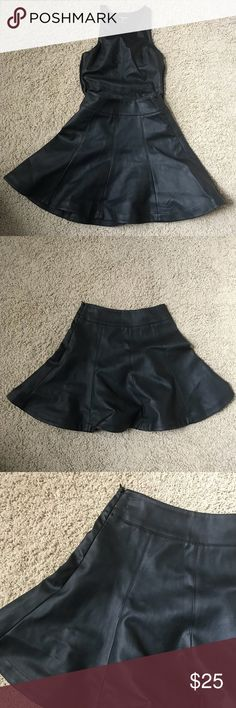 Faux Leather A-Line Flare Skirt Faux Leather A-Line Flare Skirt. In new condition. Rarely worn. Goes perfect with the faux leather top tucked into this. Perfect for petites I'm length & fit. Express Skirts