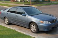 2003 Camry LE V6, great deal!!  This has been a great car.  I ended up getting a Pruis for better gas mileage.