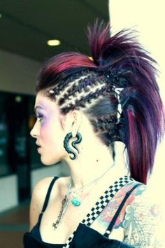 Faux hawk. Thats pretty cool! I can see my sister going all out with something like this for a big game. @Gracia Gomez-Cortazar adams. Pouf, braids, ponys.