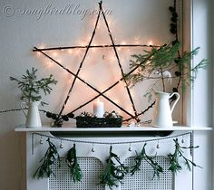 Natural Christmas Mantel Decoration A Scandinavian style natural and rustic Christmas mantel decoration with a homemade wooden star with lights silver and gold ornaments and a green garland. Christmas Mantels, Noel Christmas, Country Christmas, Winter Christmas, Christmas Lights, Christmas Crafts, Christmas Decorations, Holiday Decor, Yule Decorations