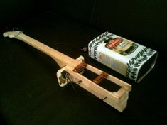 4 string can guitar with two handwound Nailpup 4 single coils and serial/parallel switch. I picked the Italian oil can out of the waste container in front o… Making Musical Instruments, Homemade Instruments, Guitar Kits, Guitar Room, Cigar Box Guitar Plans, Cigar Box Nation, Guitar Songs For Beginners, Driftwood Wall Art, Cool Stuff