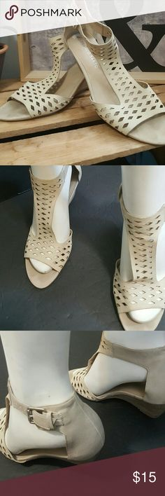 Franco Sarto 7.5 Adorable soft leather  in a creamy taupe color Slight wedge  Ankle strap is  very slimming to leg Will work with any color In great used condition Franco Sarto Shoes Sandals