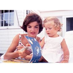"""""""There are many little ways to enlarge your child's world. Love of books is the best of all."""" -Jacqueline Bouvier Kennedy ⠀⠀⠀⠀⠀⠀⠀⠀⠀⠀⠀⠀⠀⠀⠀⠀⠀⠀⠀⠀⠀⠀⠀⠀⠀⠀⠀⠀⠀⠀⠀⠀⠀⠀⠀⠀Photo: Jacqueline and Caroline Kennedy read a book in Hyannis Port, 1959"""