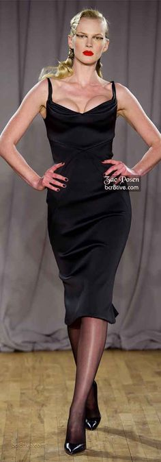 Zac Posen- I had to pin this because I just can't take this model seriously with her ridiculously lopsided cleavage.