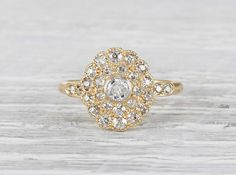 Late Victorian diamond cluster ring made in 18k yellow gold. Accented with 23 single cut diamonds. Circa 1890.