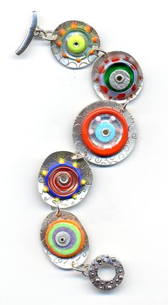 Dapped and stamped silver, riveted lampwork discs. Bracelet by AnneMade Jewelry.