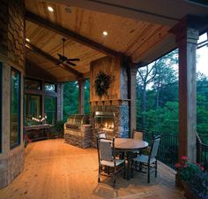 Love this outdoor cooking and eating area - I wonder if the fireplace can be viewed from the room with the bowed window?