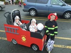 Halloween costume: Lucas as a fireman with his Dalmation Twin Brothers Jacob and Joshua decked out in their homemade fire truck stroller.