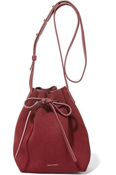 We love Mansur Gavriel's clean, minimalist design - each versatile piece suits a myriad of looks. Crafted from supple claret-hued suede, this mini bucket bag has leather drawstring ties that have become an instantly recognizable brand signature. Adjust the strap to wear yours cross-body.
