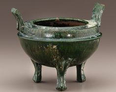 Tomb tripod vessel  early 1st-early 3rd century      Eastern Han dynasty     Earthenware with copper-green lead-silicate glaze  H: 19.0 W: 23.1 cm   China