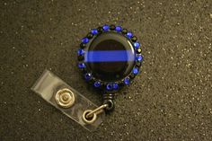 Thin blue line badge holder.. I just bought this on Etsy for $ 6