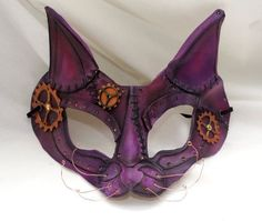 This steampunk-inspired cat mask is hand shaped from quality vegetable tanned leather, airbrushed and hand painted with hand sewn and metal hardware details. Description from etsy.com. I searched for this on bing.com/images