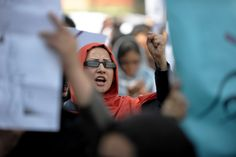 An Afghan woman shouts as she and dozens of others marched to protest violence against women in Kabul on September 24, 2012. The death of a provincial head of the Ministry of Women's Affairs, and the public execution of a woman accused of adultery underscored the level of violence that Afghan women suffer.