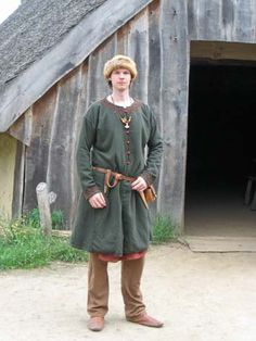 "Slavic. Dome hat, ""birka"" coat.  Note the trousers: NOT poofy norse style.  Prob. Novgorod"